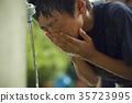 Boy baseball break water boy washing face 35723995