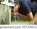 Boy baseball break water boy washing face 35724013