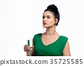 Young woman holding a champagne flute  35725585