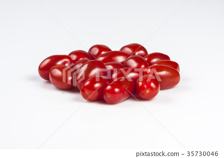 Red cherry tomatoes isolated on white 35730046