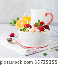 Healthy breakfast with granola and berries 35735355