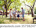 Family celebration or a garden party outside in 35736247