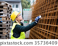 Young woman worker in an industrial area. 35736409
