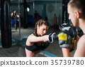 Young fighter boxer fit girl wearing boxing gloves 35739780