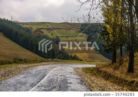 old countryside road on rainy day 35740283