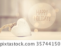 Happy Holiday message with a white heart  35744150