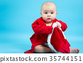 Baby girl in a Santa costume 35744151
