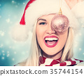 Woman holding Christmas bauble 35744154