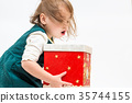 Little girl with Christmas present box 35744155