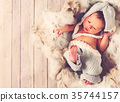Newborn baby boy in a basket 35744157