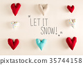 Let It Snow message with blue heart cushions 35744158