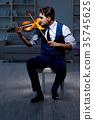 Young musician man practicing playing violin at 35745625