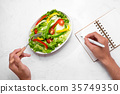 Healthy fitness meal with fresh salad Diet concept 35749350