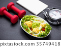 Healthy fitness meal with fresh salad Diet concept 35749418