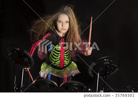 Little caucasian girl drummer with multicolored 35769301