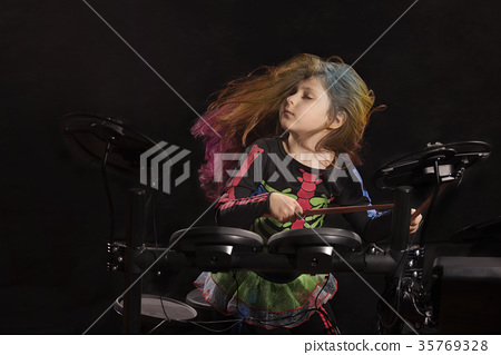 Little caucasian girl drummer with multicolored 35769328