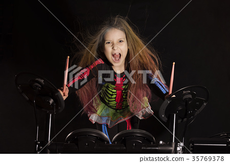 Little caucasian girl drummer with multicolored 35769378