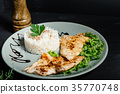 Grilled chicken breast with risotto served at pub 35770748