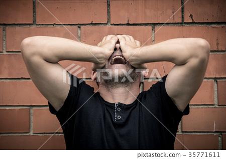 portrait one sad man standing near a wall 35771611