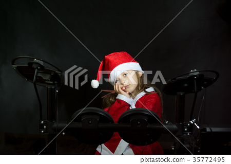 Little drummer disguised as Santa Claus playing 35772495