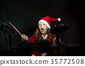 Little drummer disguised as Santa Claus playing 35772508