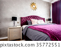 Interior of purple beautiful, cozy bedroom 35772551