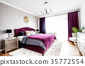 Simple and stylish bedroom interior with king bed 35772554