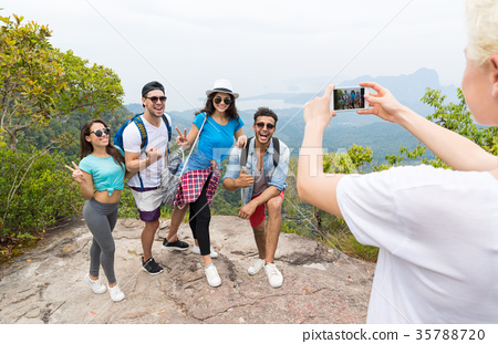 Cell Smart Phone Taking Photo Of Cheerful Tourist 35788720