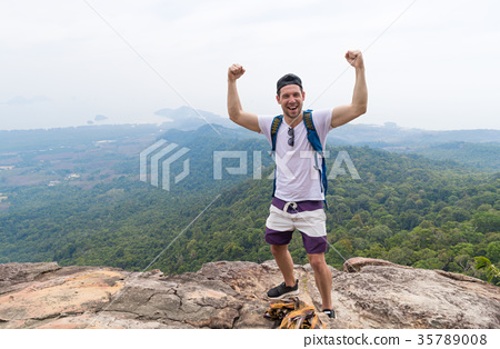 Tourist Man With Backpack Standing On Mountain Top 35789008