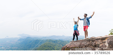 Tourist Couple With Backpack Holding Hands Raised 35789026
