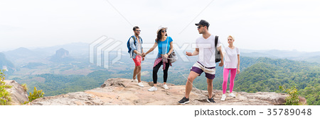 Two Tourist Couple With Backpack On Mountain Top 35789048