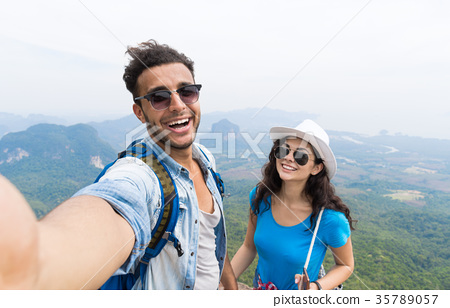Couple With Backpacks Take Selfie Photo Over 35789057
