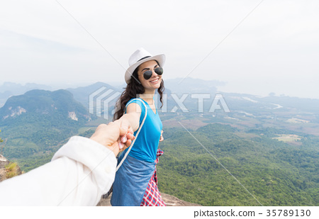 Man Hold Woman Hand, Tourist Couple On Mountain 35789130