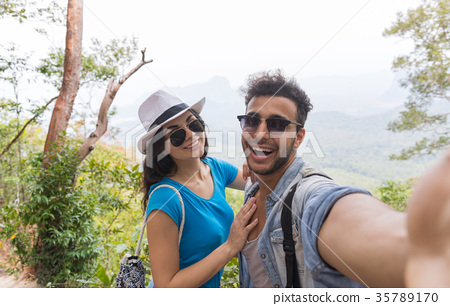 Couple With Backpacks Take Selfie Photo Over 35789170