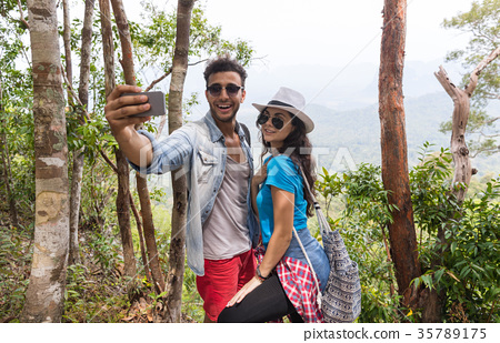 Couple With Backpacks Take Selfie Photo Over 35789175