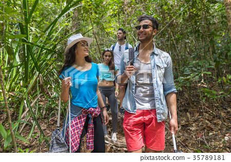 People Group With Backpacks Trekking On Forest 35789181