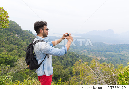 Latin Man With Backpack Take Photo Of Landscape 35789199