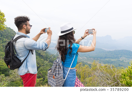 Tourist Couple With Backpack Take Photo Of 35789200
