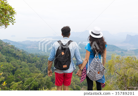 Tourist Couple With Backpack Standing On Mountain 35789201
