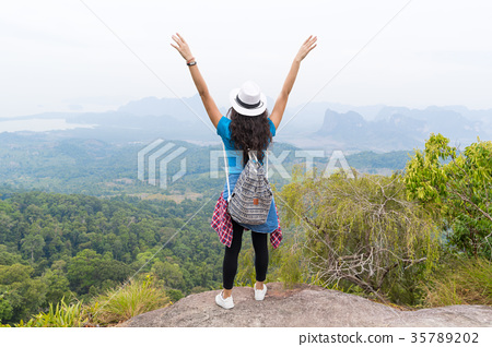 Tourist Girl With Backpack Standing On Mountain 35789202