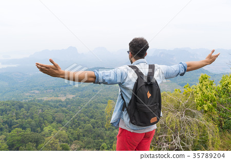 Tourist Man With Backpack Standing On Mountain Top 35789204