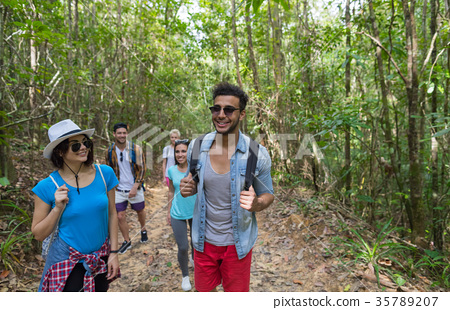 People Group With Backpacks Trekking On Forest 35789207
