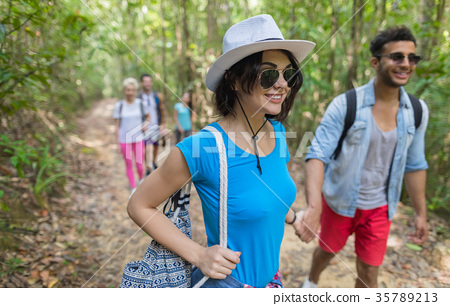 People Group With Backpacks Trekking On Forest 35789213
