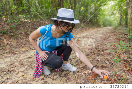 Young Girl Picking Mushroom From Ground While 35789214