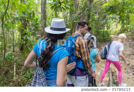 People Group With Backpacks Trekking On Forest 35789215