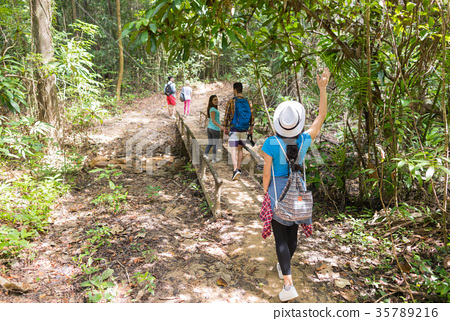 People Group With Backpacks Trekking On Forest 35789216