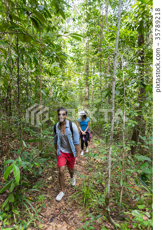 Couple With Backpacks Trekking On Forest Path 35789218