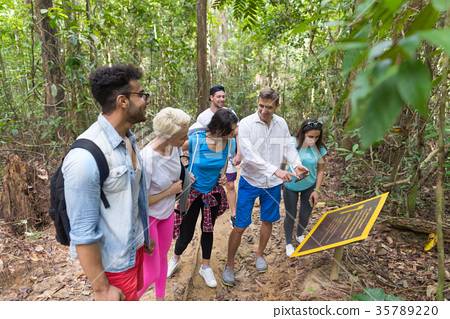 People Group With Backpacks Trekking On Forest 35789220