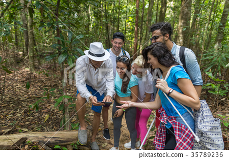 People Group With Backpacks Trekking On Forest 35789236