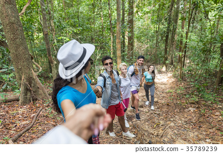 People Group With Backpacks Trekking On Forest 35789239